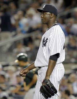 New York Yankees relief pitcher Rafael Soriano reacts at Yankee Stadium in New York
