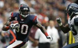 Houston Texans Andre Johnson Runs For a Gain After Making a Reception as Seattle Seahawks Marcus Trufant at Reliant Stadium in Houston