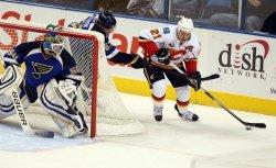 St. Louis Blues David Perron and Calgary Flames Olli Jokinen