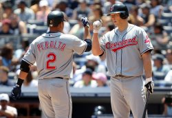 Cleveland Indians Shelley Duncan bumps fists with Jhonny Peralta at Yankee Stadium in New York