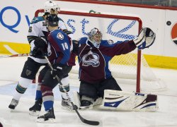Avalanche Goalie Anderson Makes a Save Against Sharks in Game Six in Denver