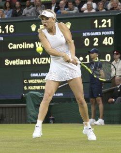 Denmark's Caroline Wozniacki returns the ball