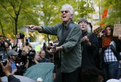 Singers David Crosby and Graham Nash perform for Occupy Wall Street protestors in New York