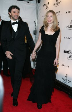 Chelsea Clinton and Marc Mezvinsky arrive for the amfAR New York Gala in New York