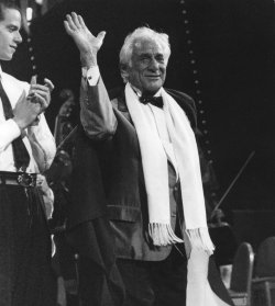 Leonard Bernstein waves to well-wishers during a 70th birthday gala thrown for him