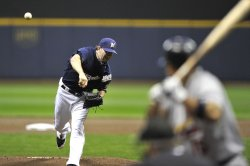 Brewers' pitcher Shaun Marcum pitches during game 2 of the NLCS in Milwaukee
