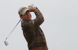 Tom Watson tees off on the 6th hole during the Open Championship in England.