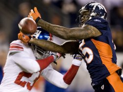 Giants Cornerback Webster Breaks Up Pass to Broncos Marshall in Denver