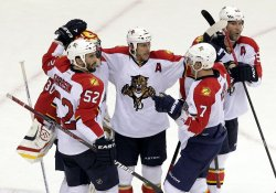Florida Panthers Scott Clemmensen (30) Jason Garrison (52) Dmitry Kulikov (7) and Brian Campbell react after the game at the Prudential Center in New Jersey