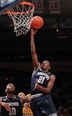 Georgetown Hoyas Greg Monroe dunks at the NCAA Big East Men's Basketball Championships Semifinals in New York