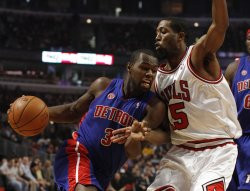 Pistons' Stuckey drives on Bulls' Salmons in Chicago