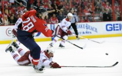 Capitals Semin passes puck to Ovechkin for a goal against the Coyotes in Washington
