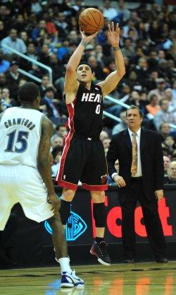 Miami Heat's Mike Bibby shoots for three in Washington