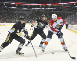 Penguins double team Panthers Mikael Samuelsson in Pittsburgh