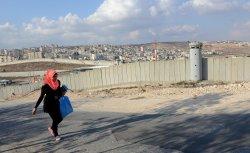 Palestinian Walks Near Israeli Separation Wall, West Bank