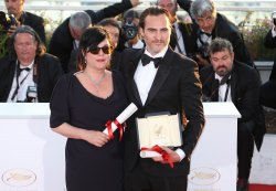 Joaquin Phoenix and Lynne Ramsay attend the Award Photocall at the Cannes International Film Festival