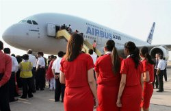AIRHOSTESSES ADMIRE AN AIRBUS A380, AT INTERNATIONAL AIRPORT IN NEW DELHI,