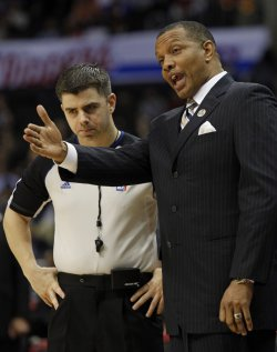 Suns coach Alvin Gentry argues with the referee in Los Angeles
