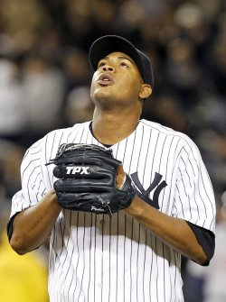 New York Yankees starting pitcher Ivan Nova tips his cap in Game 1 of the ALDS at Yankee Stadium in New York