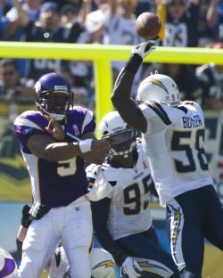 Vikings Donovan McNabb has pass knocked down by Chargers Butler during game San Diego, California