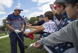 Phil Mickelson greets fans during a Ryder Cup Practice Round