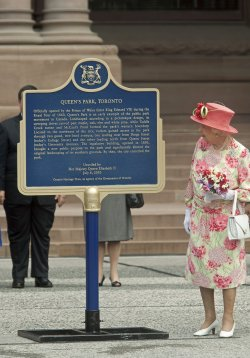 Queen Elizabeth and Prince Philip attend their official departure ceremony at Queen's Park in Toronto on their Royal Tour of Canada