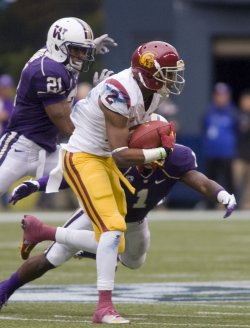 USC Trojans wide receiver Robert Woods runs after catching a pass against the Washington Huskies in Seattle.