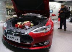 Chinese visit a Tesla showroom in Beijing
