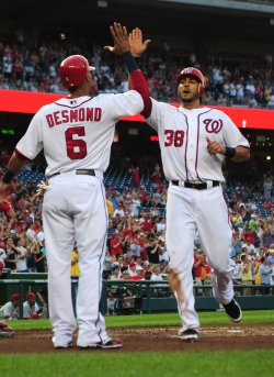Nationals' Michael Morse is congratulated by teammate Ian Desmond in Washington