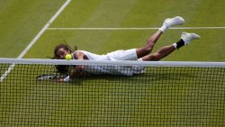 Dustin Brown dives at 2013 Wimbledon Championships
