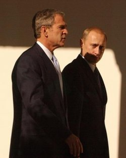 Russian President Vladmir Putin visits with President George W. Bush