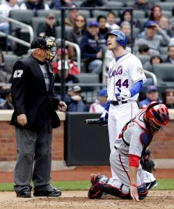 New York Mets starting pitcher Jason Bay argues with home plate umpire Larry Vanover at Citi Field in New York