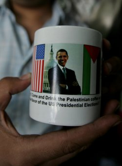displays mugs for sale with portraits of US President Barack Obama in Gaza