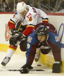 Flames Bouwmeester Crashes into Avalanche Yip in Denver