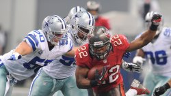 Cowboys Sean Lee (50) and Jason Hatcher close in on the Buccaneers Doug Martin at Cowboys Stadium in Arlington, Texa