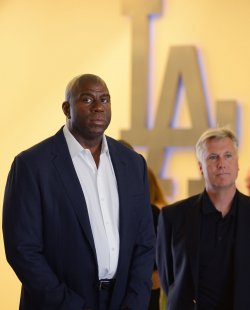 """Earvin """"Magic"""" Johnson and Mark Walter participate in a news conference to announce Dodgers blockbuster trade in Los Angeles"""