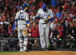 Texas Rangers catcher Mike Napoli talks to pitcher Darren Oliver during game 6 of the World Series in St. Louis