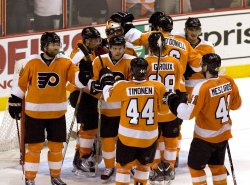 Flyers goalie Brain Bouchermobbed by players after the game in Philadelphia.