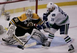 Canucks Higgins attempts shot on Bruins Thomas in game 3 of Stanley Cup Finals in Boston, MA.