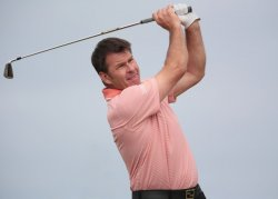 Nick Faldo drives on the 8th tee at the Open Championship