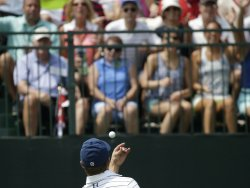Jordan Spieth throws a golf ball to fans at the PGA