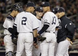 New York Yankees Jorge Posada, Derek Jeter, relief pitcher David Robertson, Alex Rodriguez and manager Joe Girardi stand on the mound in Game 3 of the 2010 ALCS at Yankee Stadium in New York