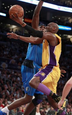 Los Angeles Lakers' Lamar Odom, right, goes to the basket as Dallas Maverick's Brendan Haywood defends in the second half of Game 2 of the Western Conference semifinals