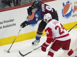 Avalanche Duchene Skates with the Puck Against Red Wings Salei in Denver