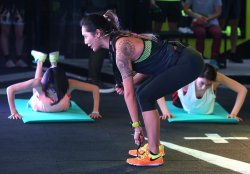 A Chinese instructor demonstrates an exercise at a Nike-sponsored workout in Beijing