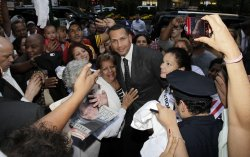 Alex Rodriguez greets supporters at MLB offices.