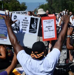 Large crowd rallys in Los Angeles to protest spate of police killings in America