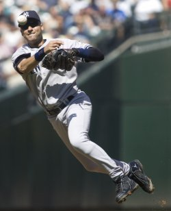 New York Yankees shortstop Derek Jeter throws out Seattle Mariners Jose Lopez in the first inning at SAFECO Field in Seattle.