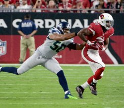 Cardinals' Johnson is pushed out of bounds