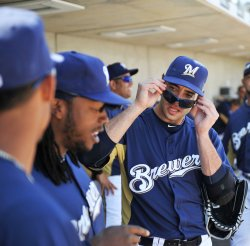 Ryan Braun puts on his sun glasses at spring training in Arizona